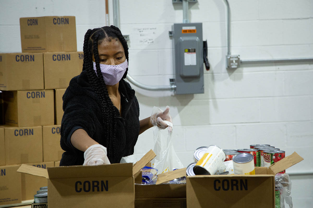 Team member helps pack boxes for Convoy of Hope